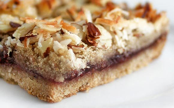 In fact, these decadent raspberry coconut-almond bars should come with a warning: Be careful who you share these with.