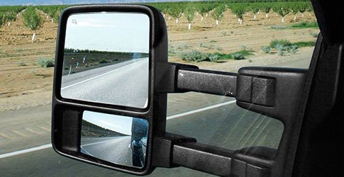 Released Mirror Head CIPA's Magna Extendable Replacement Towing Mirror has a mirror head that can be released and slid outward 4.5 inches to add visibility for towing. K-Source Clip On Towing Mirror The K-Source Clip-On Towing Mirror snaps over your existing factory mirror assembly to provide a second mirror that's helpful during towing.